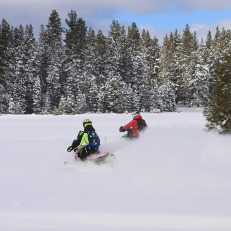 Explore! Sierra Touring Company hosts Jonny Moseley and his film crew of Visit California on the snowmobile tour having fun